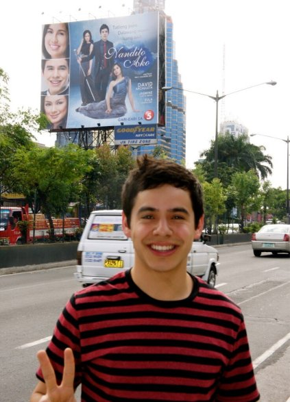 David Archuleta standing in front of Nandito Ako billboard